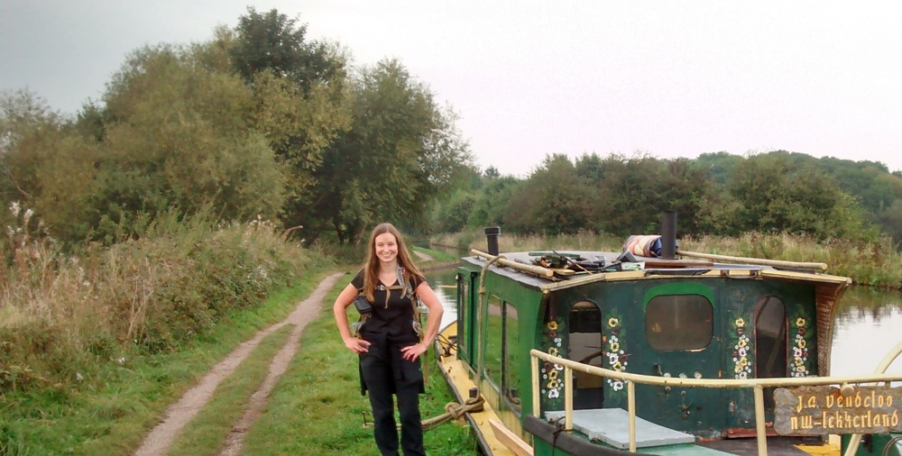 My friend posing by a canal boat