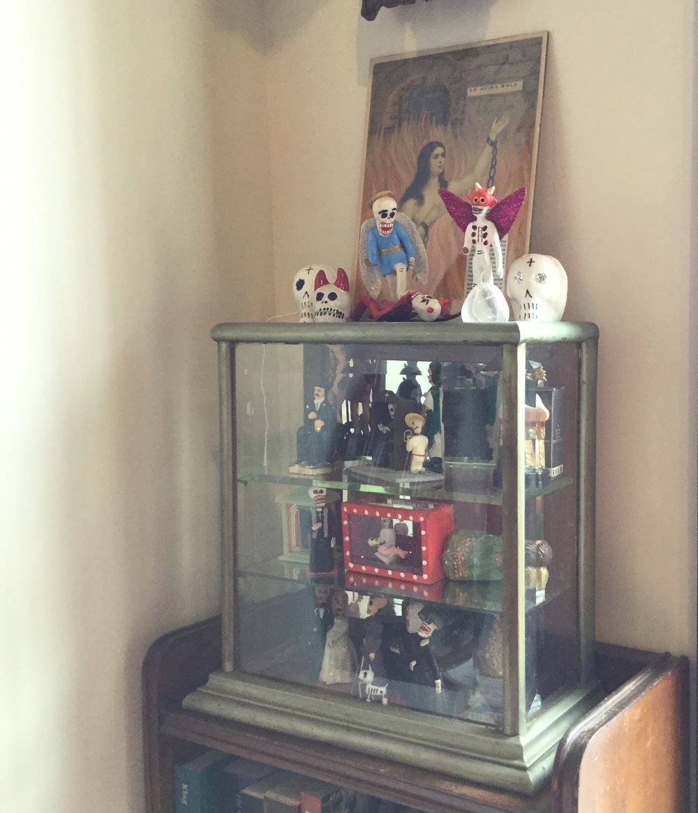A cabinet in the Morbid Anatomy Museum which houses Mexican memento mori.