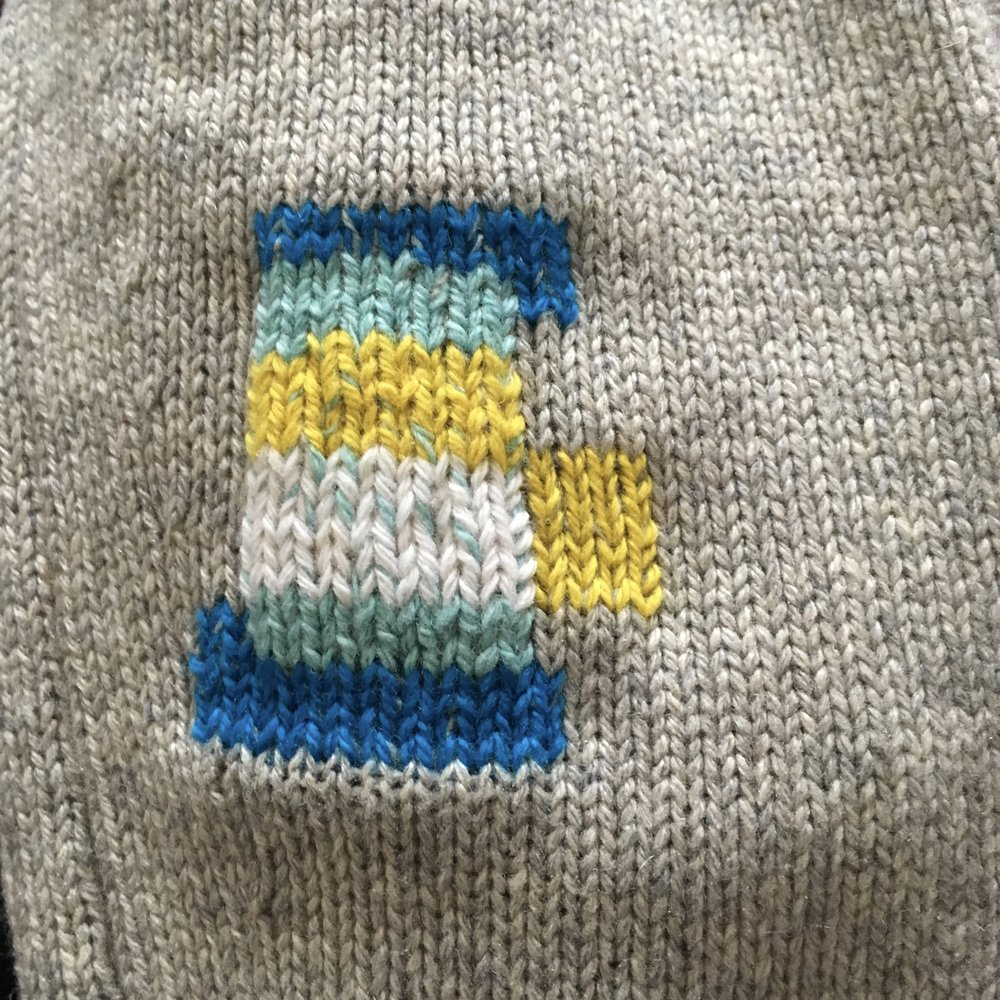 I decided to add blocks of colour outside the original area for mending using more Swiss darning, The surrounding area was thinner than the rest of the cardigan, so the extra colour blocks will help to strengthen it.