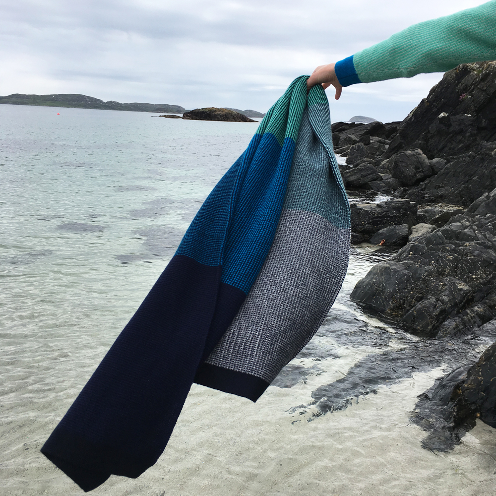 Tiree Scarf, with blues ranging from dark deep waters to light clear seas.