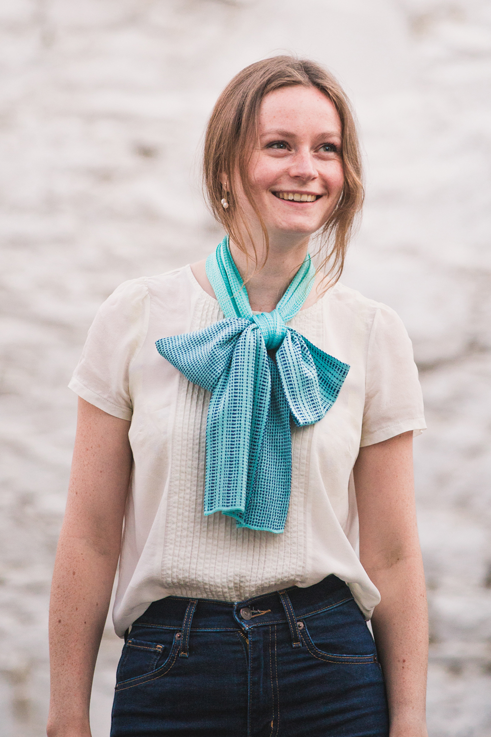 Why not try a bow? Silk has a wonderful drape that's great for this.