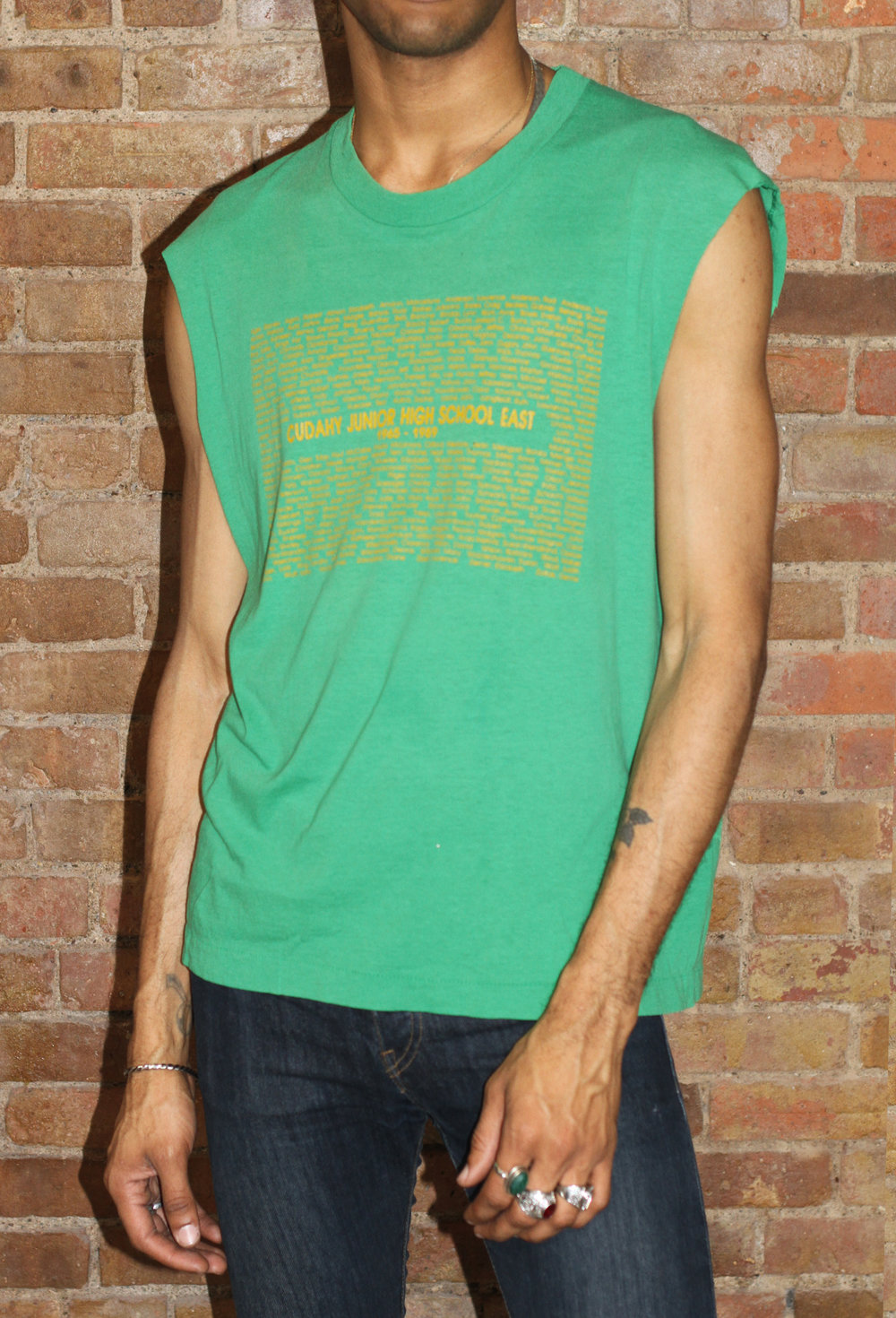 VINTAGE 60s GREEN SLEEVELESS TEE - HEARTLESS CLOSETThis is sexy, classic, and versatile. Timeless style of vintage curated by CCO Drew Miles Davis. Splash the scene with this easy piece. Layer it or show off some tattoos.