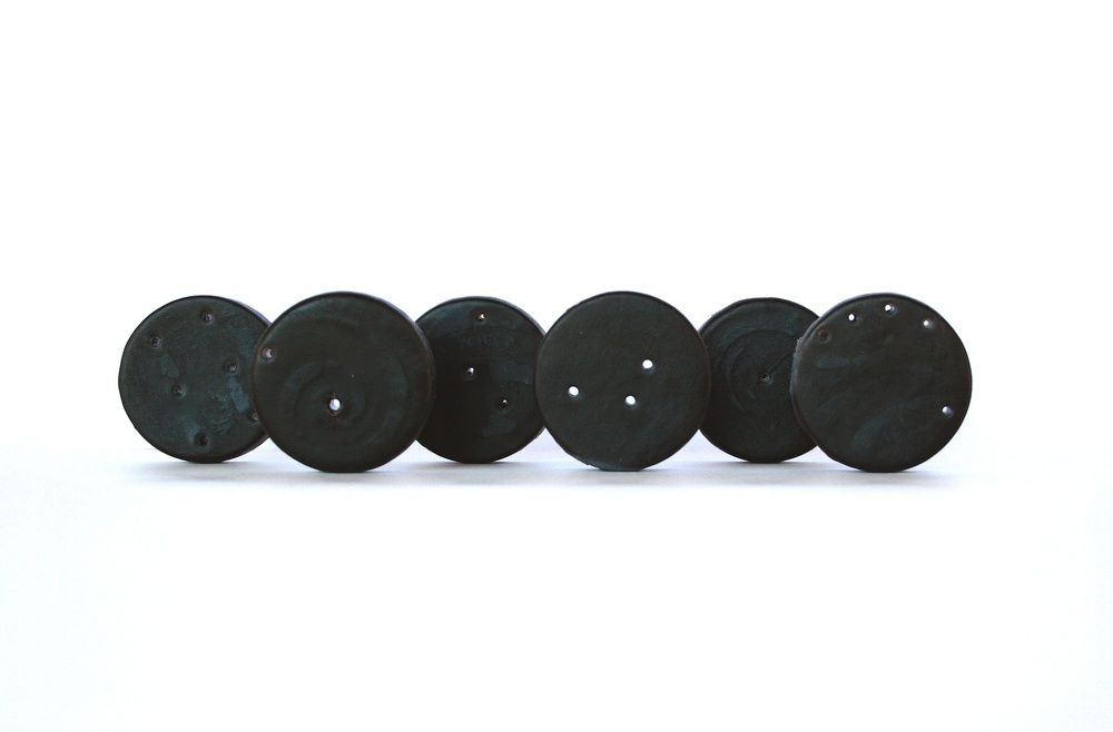Christine Kettaneh,  Soap Coins , post-side2, laser-engraving on soap, 2014.