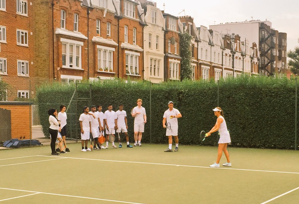 Queens Club coaches deliver tennis clinic