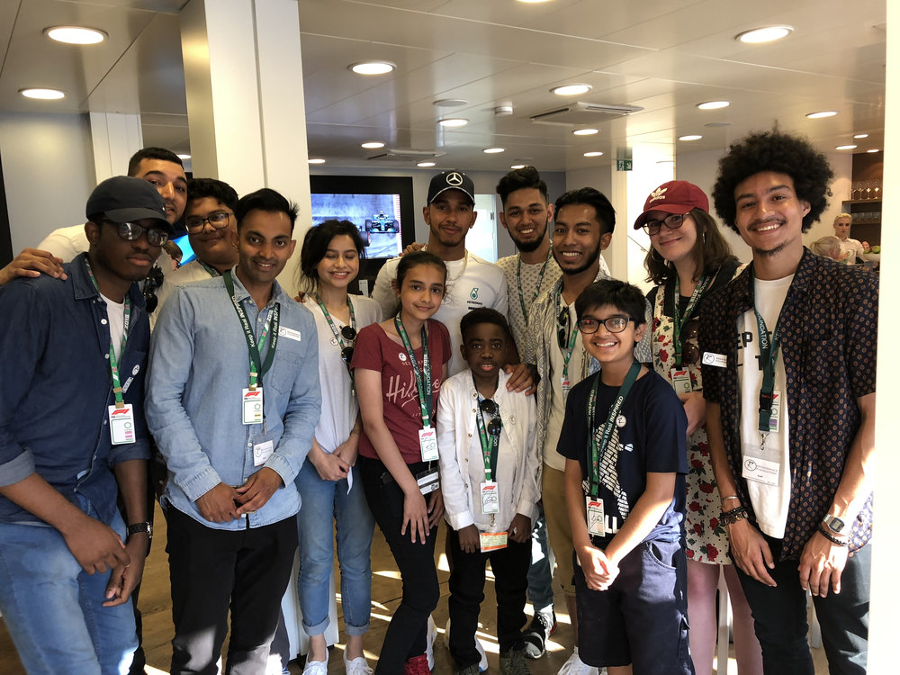 Our Young Leaders meeting Lewis Hamilton, who was himself a young carer, at the F1 Press Day at Silverstone in 2018.