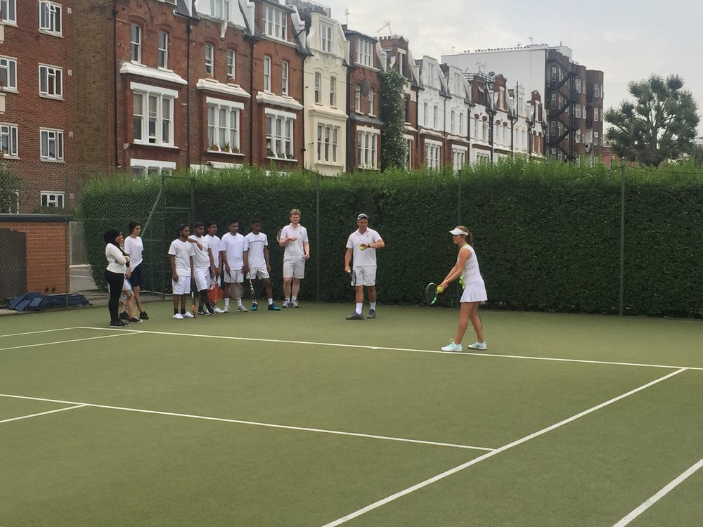 At a tennis session at Queen's Club