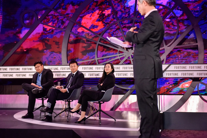 Judges Hans Tung, Managing Partner, GGV Capital, Davis Wang, Co-founder and CEO, Mobike, Anna Fang, CEO and Partner, ZhenFund and Moderator Adam Lashinsky