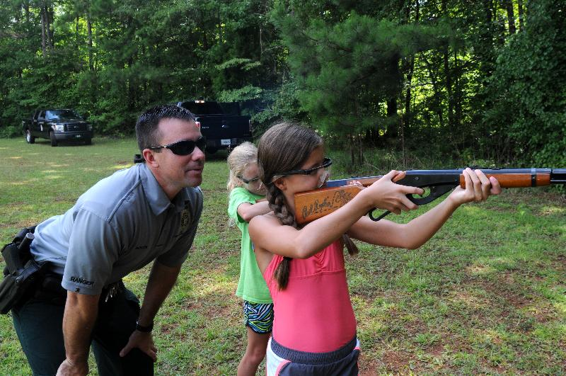 Cpl. Jeremy Bolen watches a student shooting BB guns at rockridge Baptist assembly august 2013.jpg