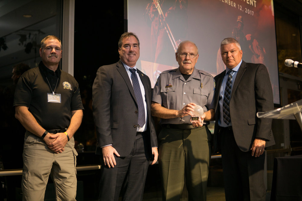 From left: Randy Stark, Executive Direcotr National Association of Conservation Law Enforcement Chiefs, Ed Grace acting Chief of USFWS Office of Law Enorcement, Larry Yamnitz, Greg Jackson Special Agent in Charge USFWS Midwest.