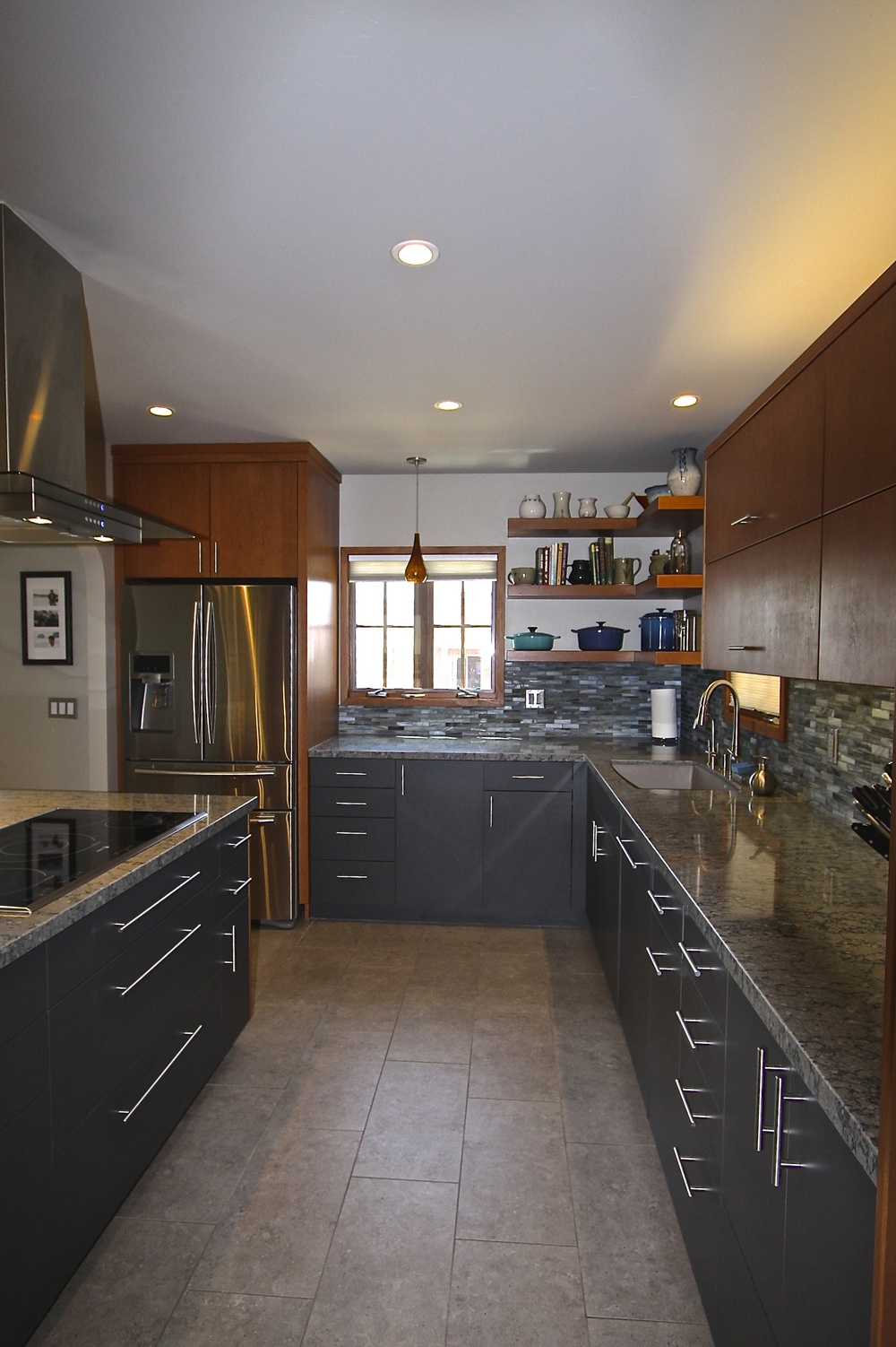 After: A really well designed space. The custom cabinets by Creative Woodworks included most of the bells and whistles the owners were hoping for.