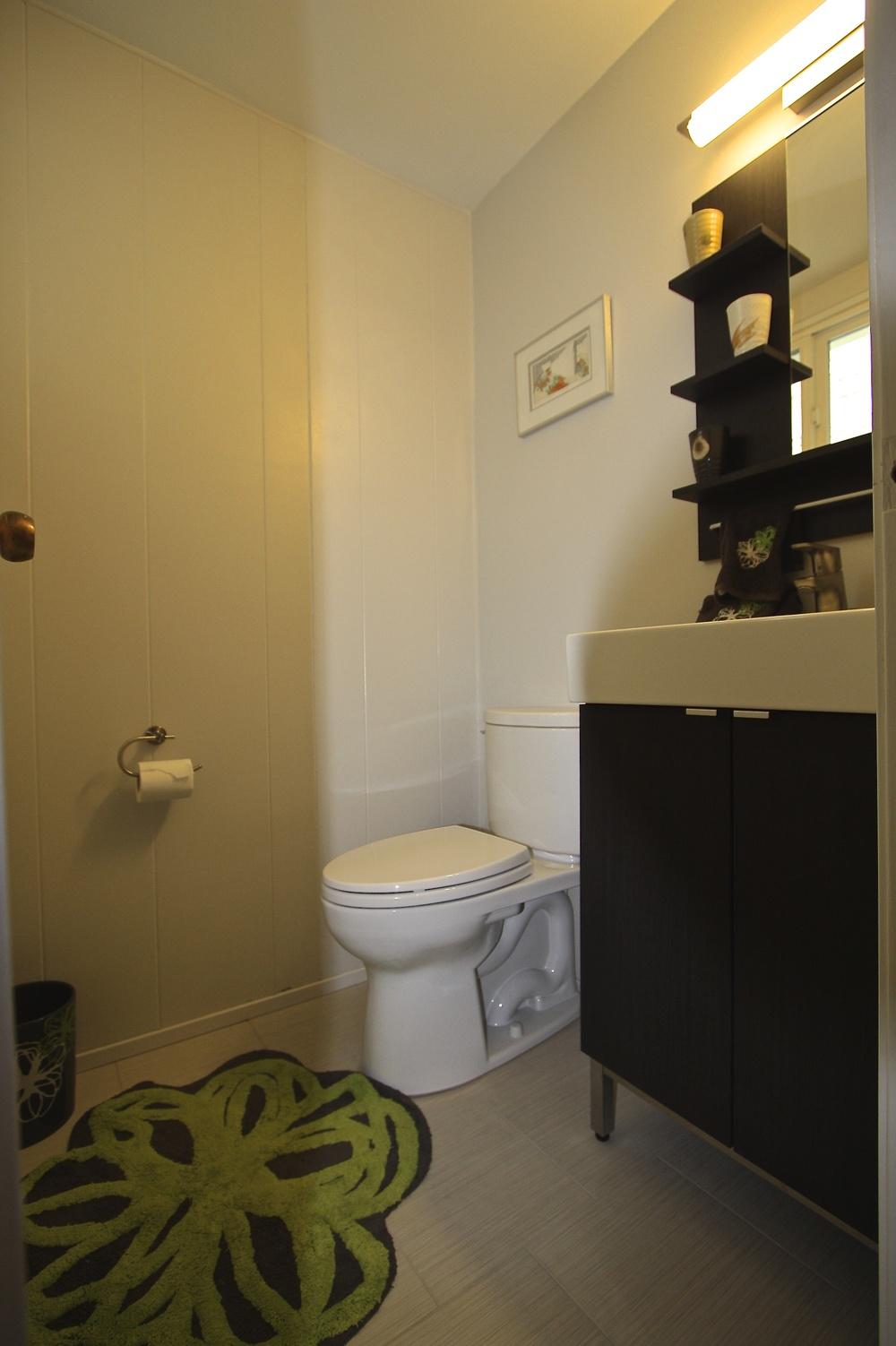 Half bath was reduced by about 6 sq. ft. to allow a wider hall.