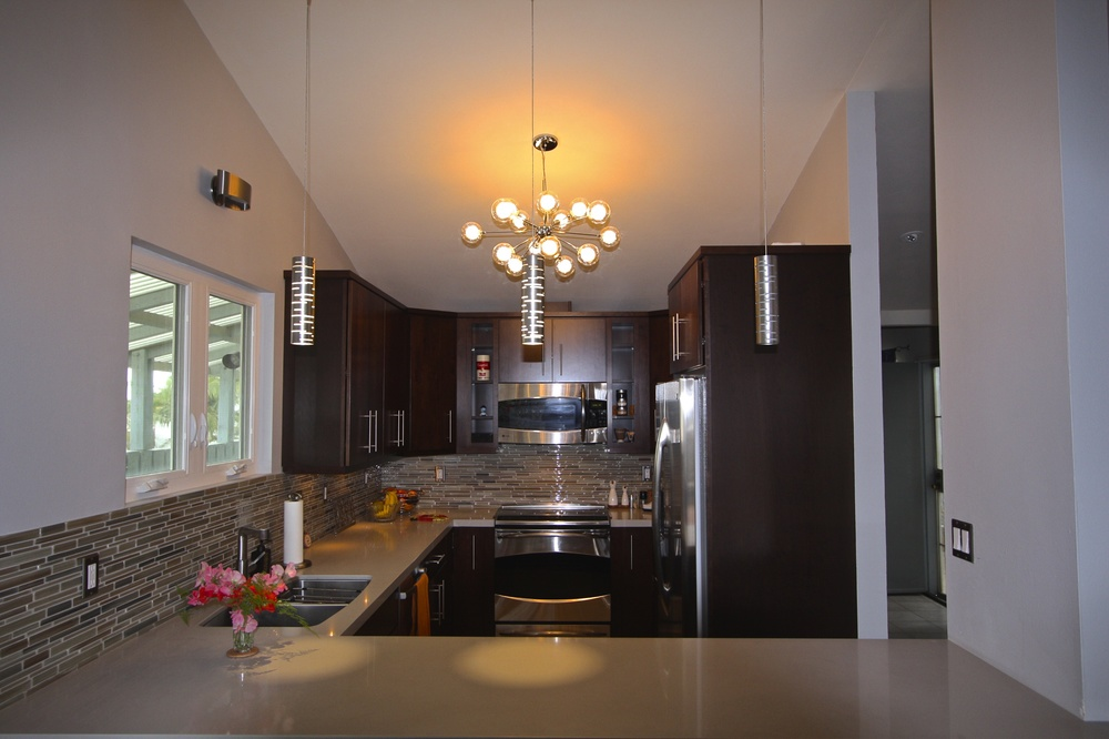 After: Beautiful countertop, backsplash tile and really great modern lighting.