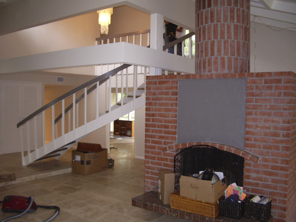 After: The only change to the fireplace was painting the white stucco. Note the great round chimney. All flooring on first floor is 18x18 travertine.