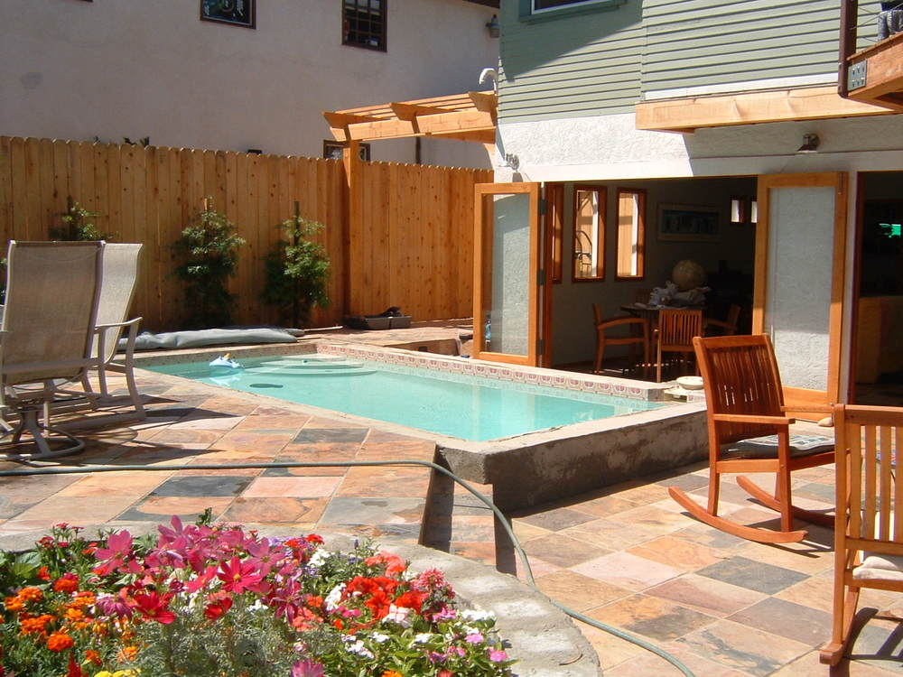 Patio, pool and full opening glass doors create a nearly seamless transition from indoors to outdoors.