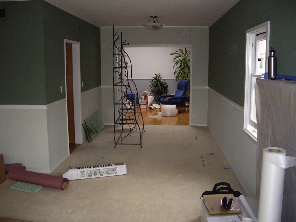 Before: Dining room looking toward 1992 addition. Kitchen was accessed through left door.