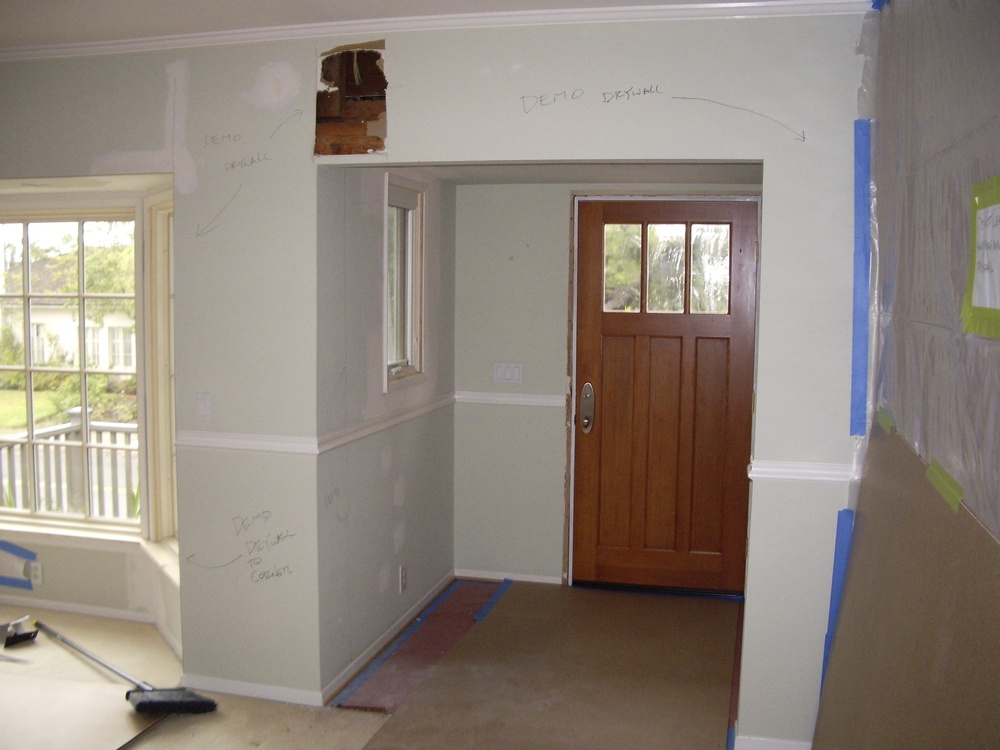 Before: Unwelcoming foyer with low ceiling.