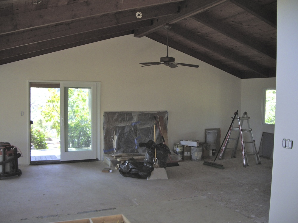 After: Light walls really make the wood ceilings come to life.
