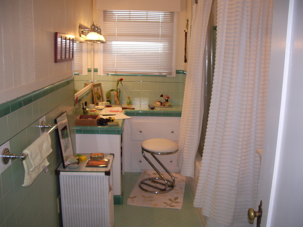 Before: Painted wood cabinets, cloth shower curtain.
