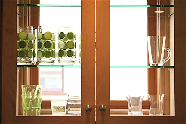 R. Lyle Boatman, designer for the project, created this amazing way to bring in more natural light to the kitchen by putting fixed windows in the cupboards.
