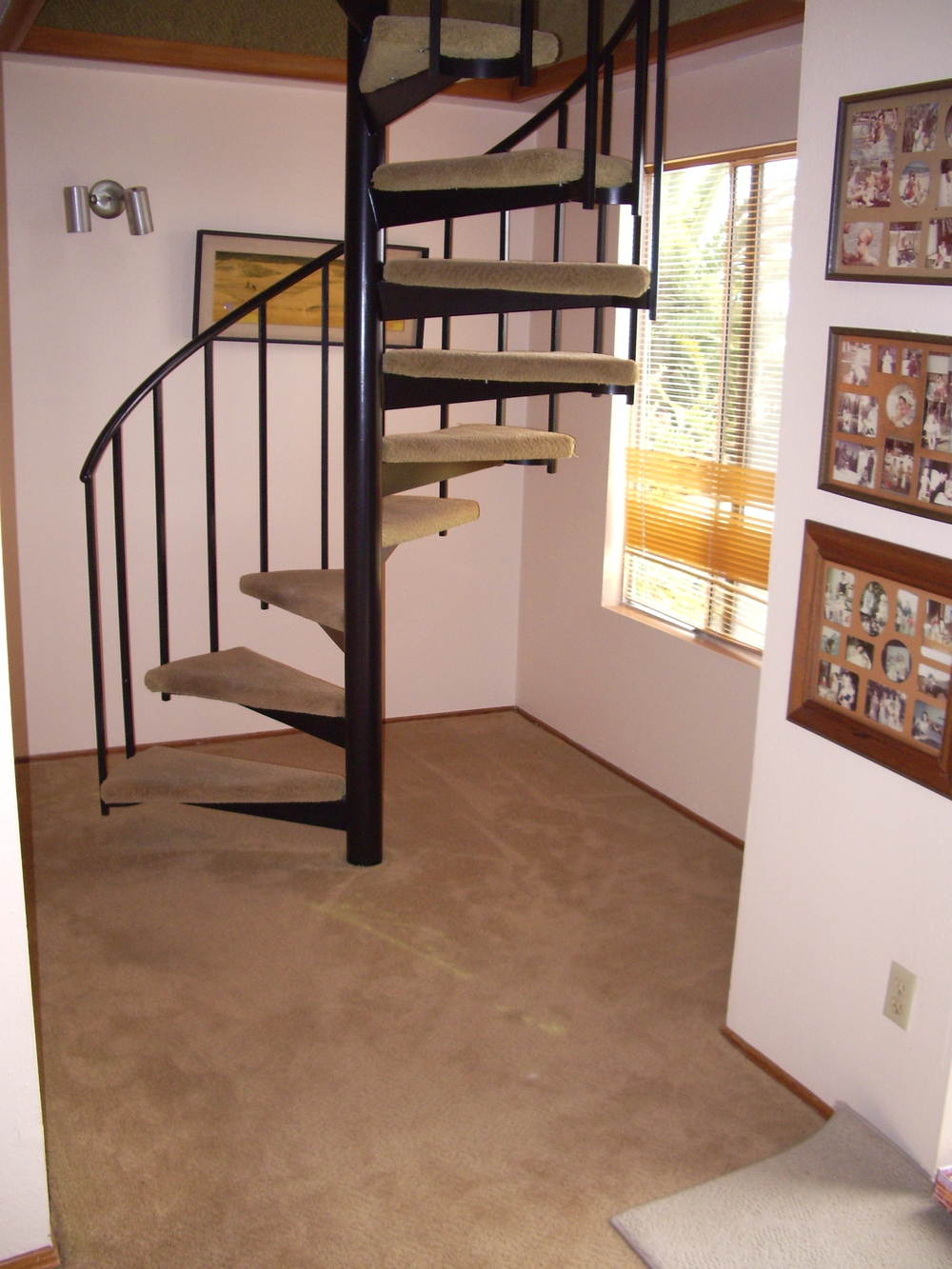 Before: Carpeted floors and stairs.