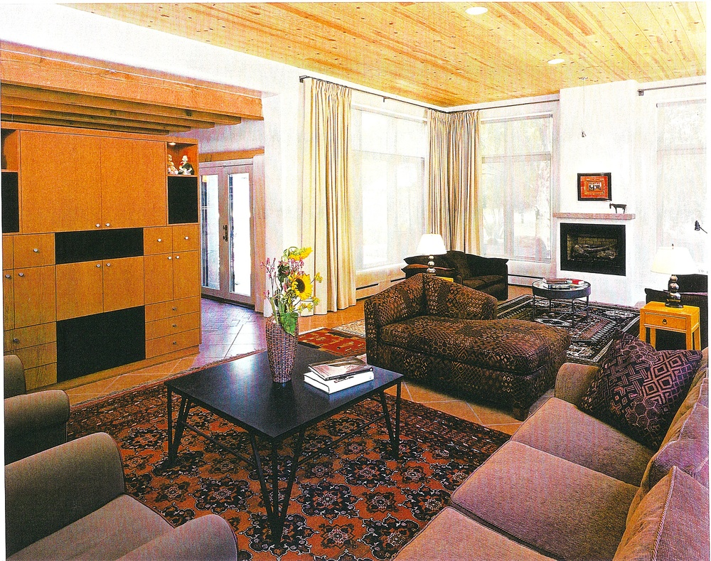 Living room featuring custom made entertainment center.