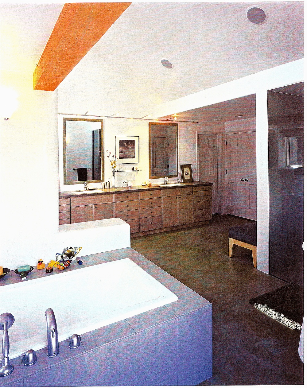 Master bathroom featuring stained concrete floor.