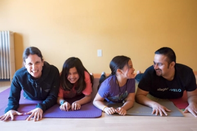 """Family yoga helps us appreciate togetherness, hilariousness, challenge, and small victories like touching your toes or doing a handstand. Yoga doesn't have to be vinyasa after vinyasa. There are so many yoga approaches that can be mixed creatively to make a great and unique session. We made up some new family asanas, like 'angry snail' (pictured) and 'stacked up down dog.'""- The Simian Family                                                             (Photo by Eva Lin Douglass)"