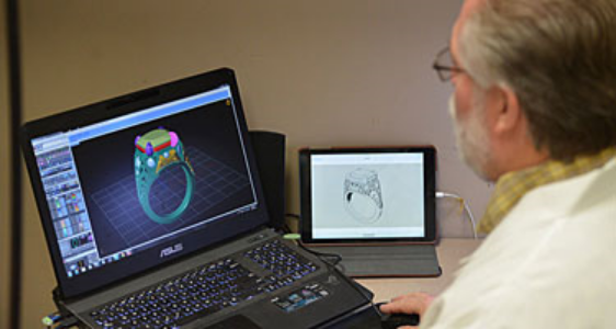 Ron Litolff designing diamond ring on computer.