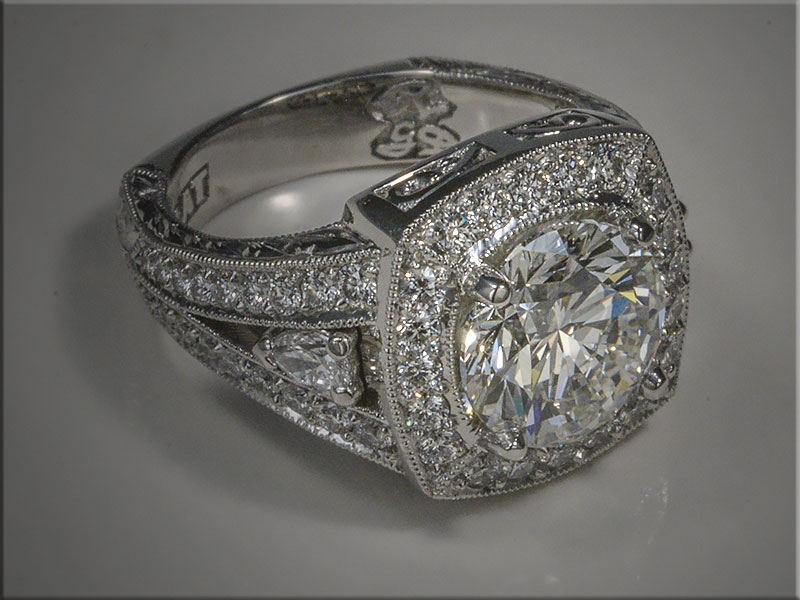 Diamond ring with 3 ct center diamond.