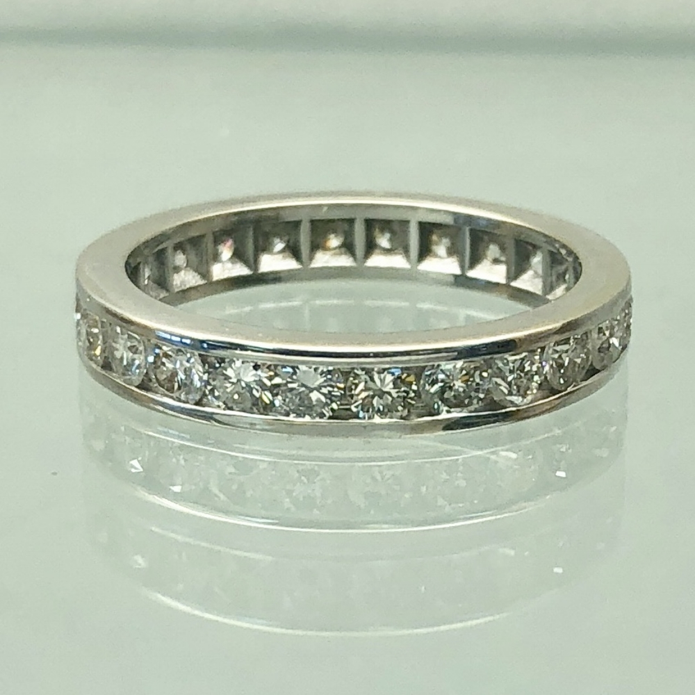 $1399          Diamond Eternity Band - 1 carat total round brilliant diamonds channel set all the way around in a 14 karat white gold band. Diamonds are SI-1 clarity and G/H in color. SIze 5.5, 3.25mm wide, 2.6 grams.