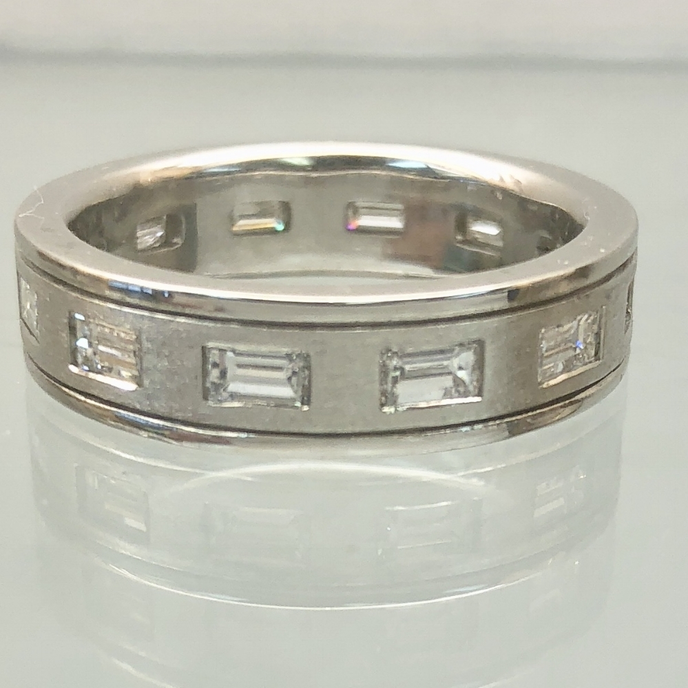 $2499          Plat/Diamond Band - 1.85 carats total of diamond baguettes set in a platinum band. 16.0 grams, 6mm wide, size 9.75. Diamonds are VS clarity and H/I color.