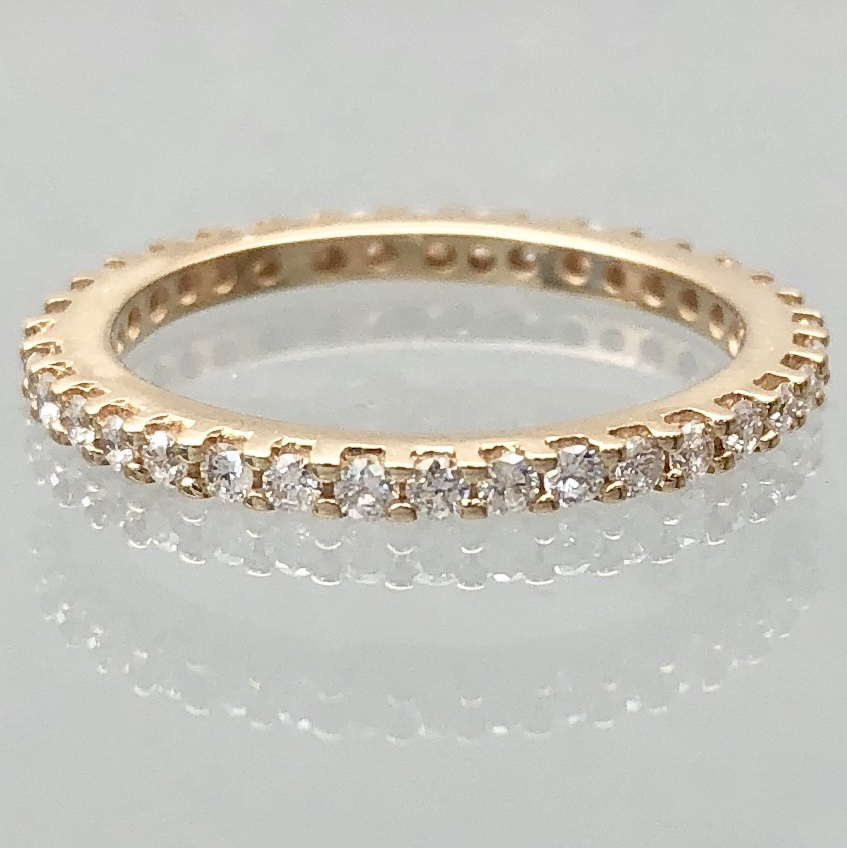 $499          Diamond Eternity Band - 14k yellow gold diamond eternity band with 0.36 carat total of round brilliant cut diamonds. The diamonds are I1-SI1 clarity and I/J in color. Size 5, 1.6mm wide, 1.6 grams.