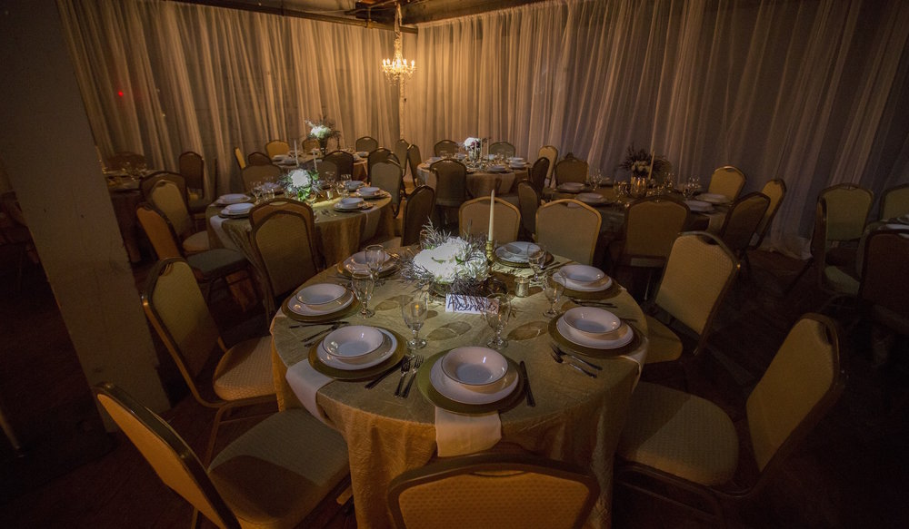 White sheer drapery with a warm lighting from the crystal chandeliers.