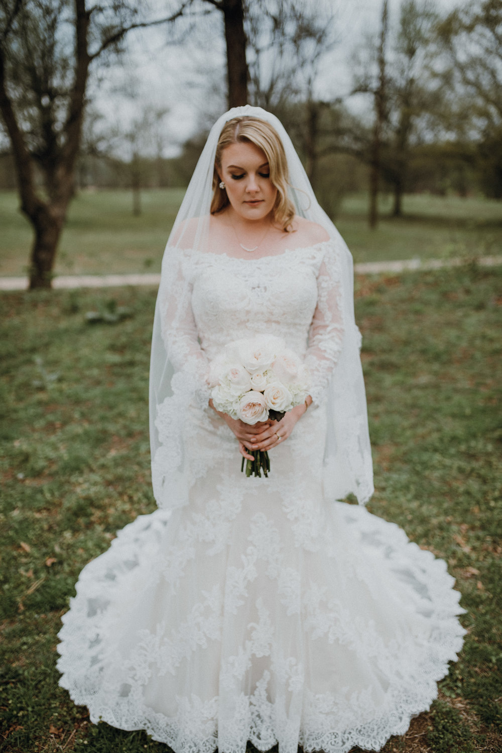 Dress by Morilee by Madeline Gardner, Bouquet by L Designs, Hairstyle by Shelby Barham.