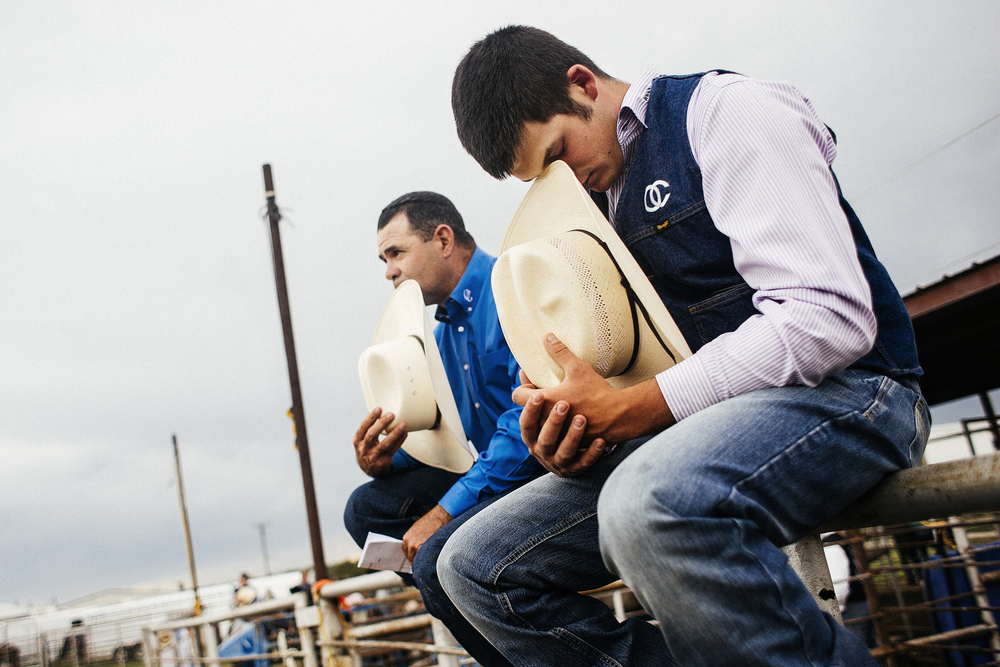 Every beginning of a rodeo starts with the national anthem and a prayer. Here is the coach of Odessa College, C.J. Aragon, with one of the athletes, Jake Trujillo.