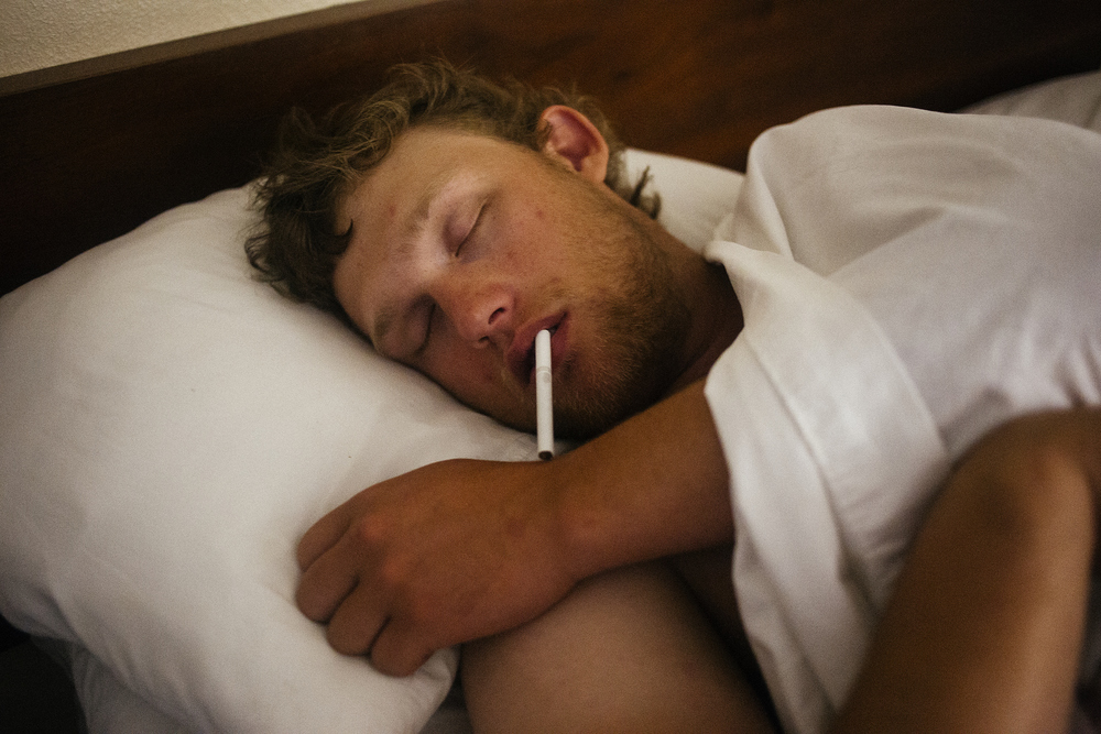 Ty Ellis after the last college rodeo of the season in Stephenville, Texas. His roommates and girlfriend put a cigarette in his mouth, to try and convince him that he smoked cigarettes the night before, even though he never smoked before.