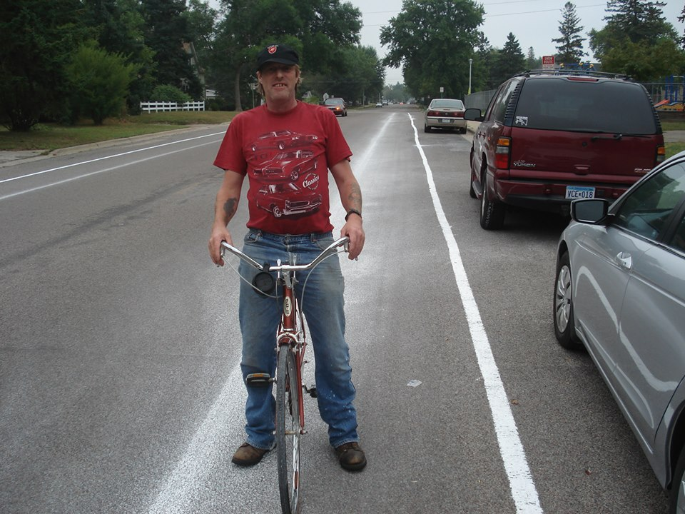 In my hometown, we used chalk to temporarily narrow driving lanes. With a few hours, bikers -- a rare and endangered species in Brainerd -- showed up to use this space. Even though it slowed traffic in a problematic area next to a school, making this striping permanent would violate state aid design standards.