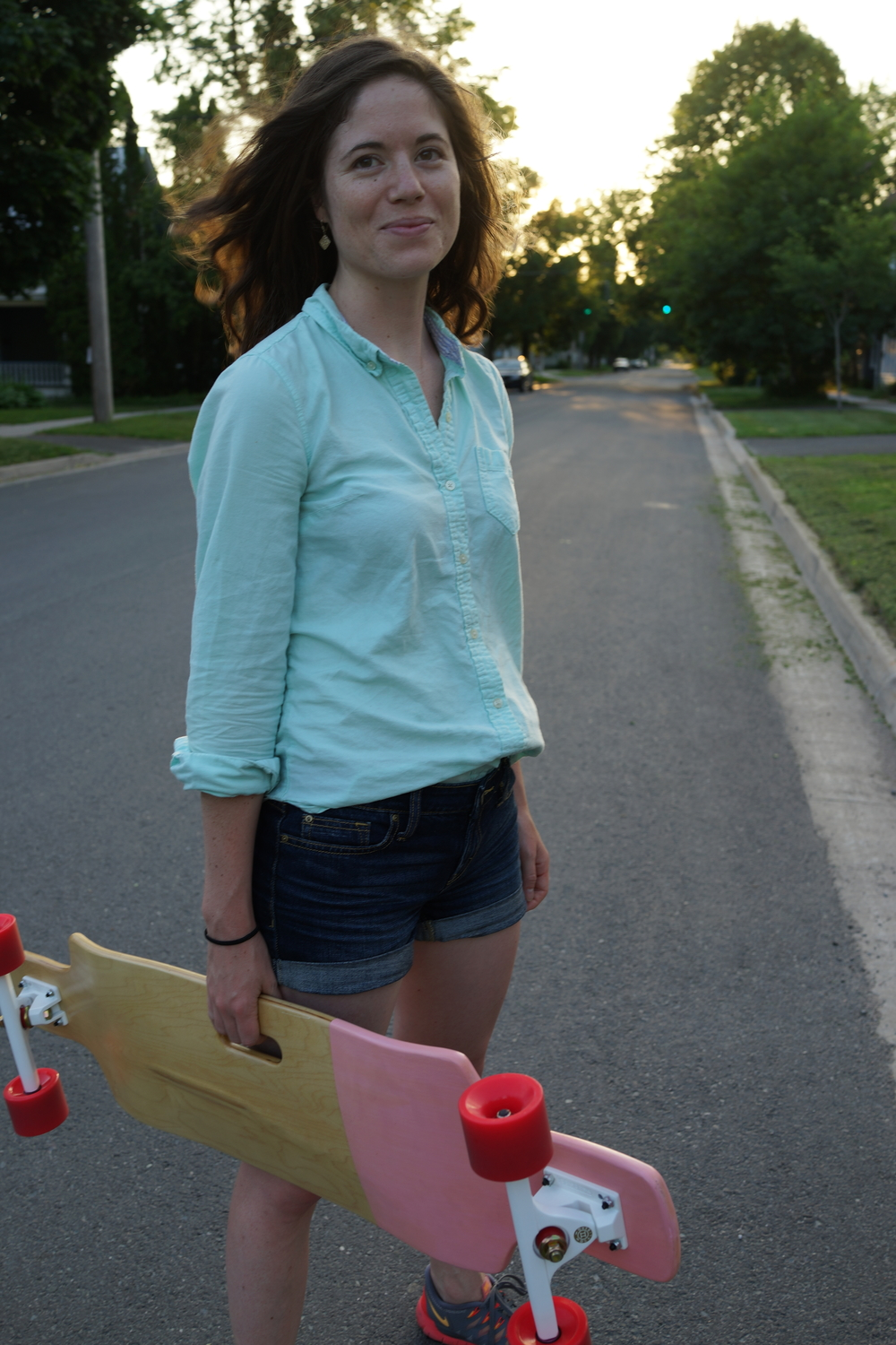 Carrying my trusty strawberry shortcake longboard by Limbic in Fredericton, NB