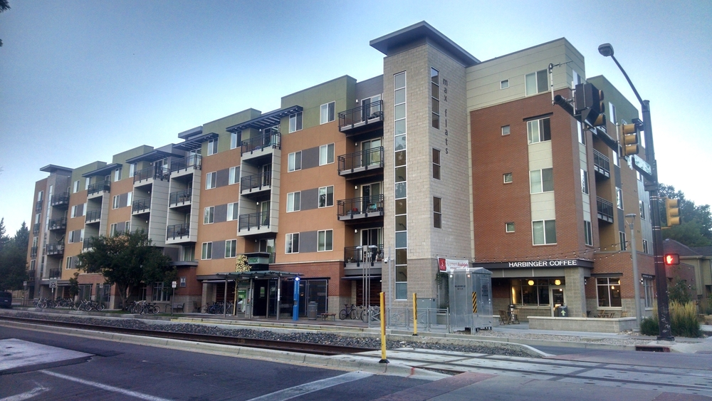 Max Flats with transit station in front and an excellent local coffee shop at street level.