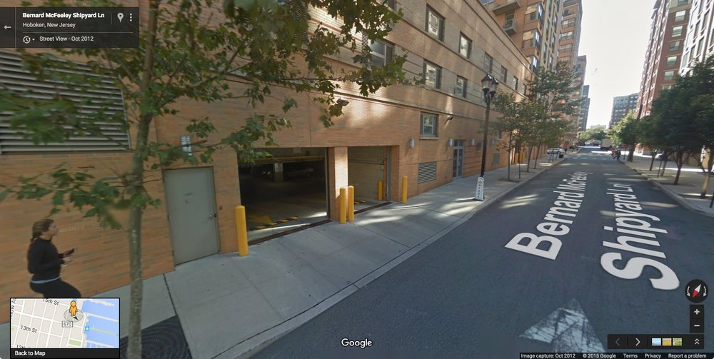 A parking structure of an apartment building creating a dead street. You do not have to be very creative to think of a better design.