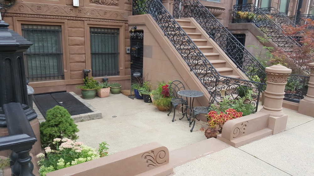 A pleasing front courtyard of a multi-family dwelling. Modern regulations would probably encourage the developer to make this a driveway to a garage instead.
