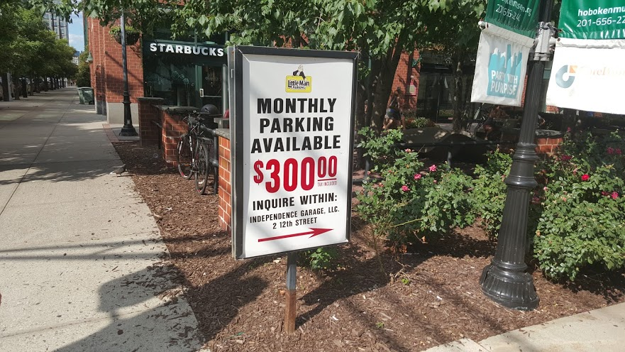 A parking garage in Hoboken advertising parking spaces for $300/month.