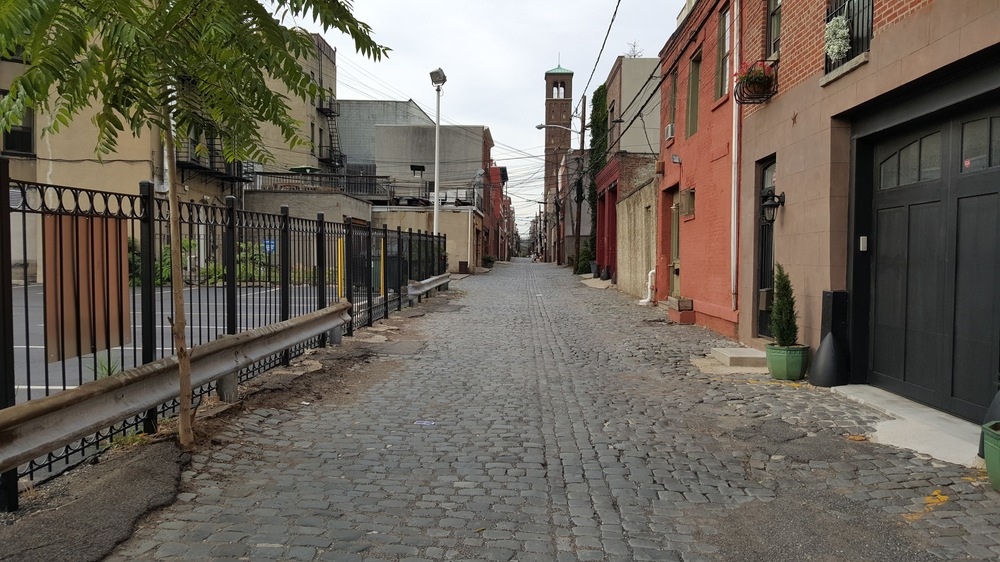 A parking lot along an alley in Hoboken, NJ. A waste of space, but relatively unobtrusive in moderation.
