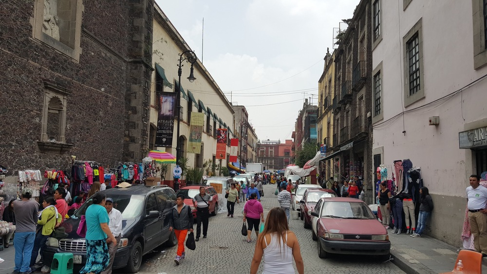 """Parking strips"" in Mexico City creating a wall of cars on either side."