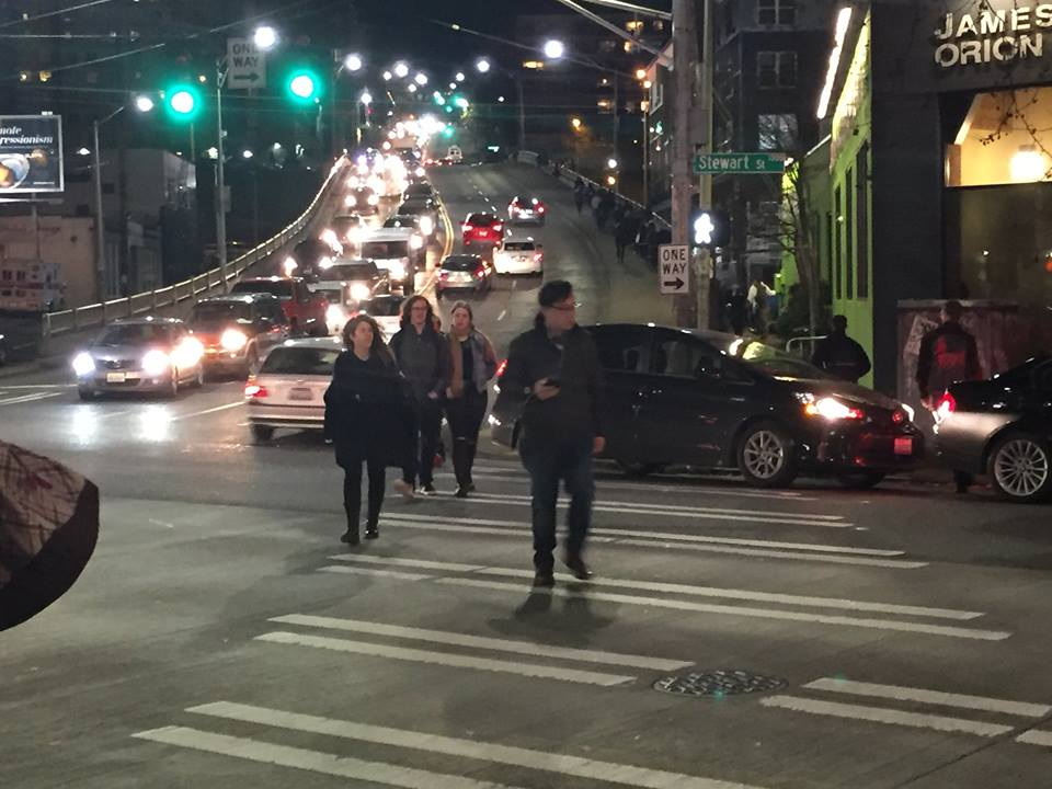 Workers face a gauntlet of cars as they walk to work from the dense Seattle Capitol Hill neighborhood to the employment center of South Lake Union. Transit along this corridor is infrequent and unreliable in part because of traffic congestion.