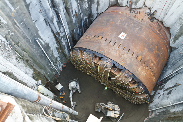 Bertha struck a steel pipe in December 2013, which supposedly caused the breakdown that sidelined the TBM for more than two years. The contractor had to dig the TBM out and hoist it to the surface to conduct the repairs to get it running again. Incidentally, the excavation pit probably was the cause of Pioneer Square sinking more than an inch. (WSDOT)
