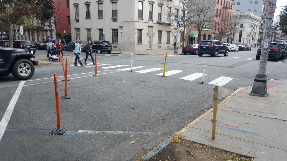 The 'danger zone' being narrowed with plastic poles in Hoboken.