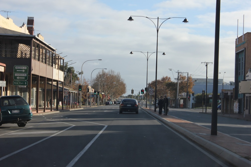 A street in Adelaide with people waiting on a pitiful island in the middle.