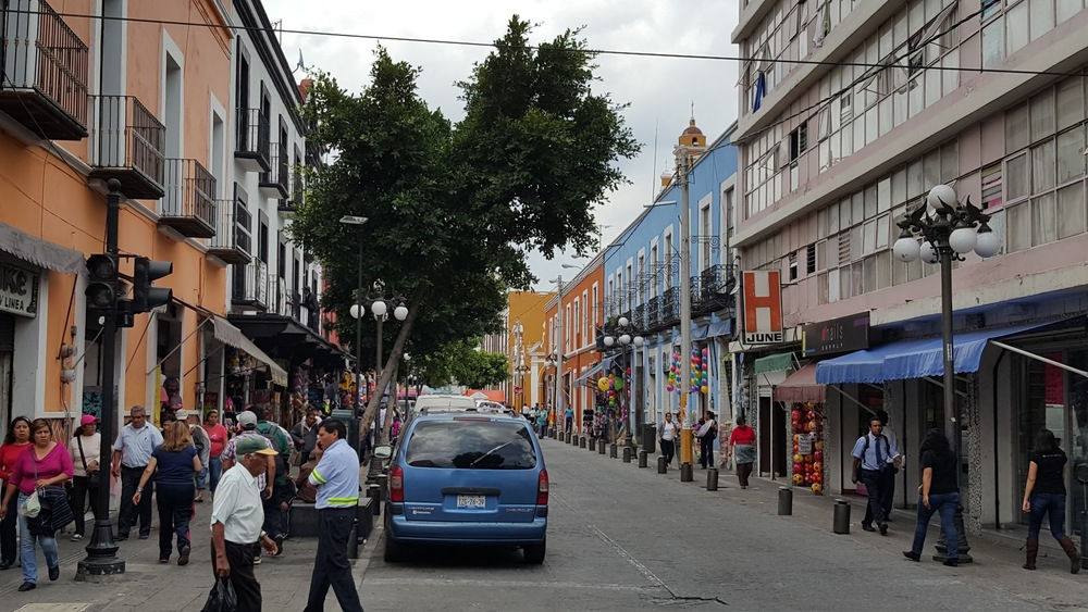 The building to the very right is ugly, but because the street is fine-grained, it does not destroy the overall aesthetics of this street in Puebla, Mexico.