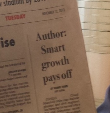 "Newspaper headline: ""Author: Smart growth pays off"""